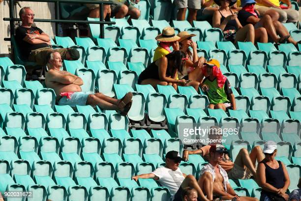Spectators sit in the sun with their shirts off as Sydney experiences a heat wave during day four of the Fifth Test match in the 2017/18 Ashes Series...