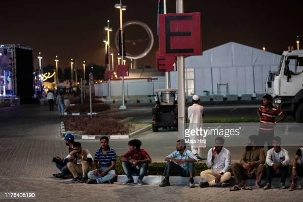 Spectators sit near the Stadium during day five of 17th IAAF World Athletics Championships Doha 2019 at Khalifa International Stadium on October 01...