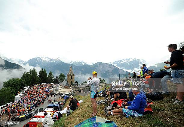 Spectators sit on a hill over lookiing Dutch corner during stage eighteen of the 2013 Tour de France a 1725KM road stage from Gap to l'Alpe d'Huez on...