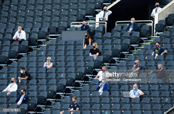 Spectators sit socially distant during the Premier League match between Newcastle United and Aston Villa at St. James Park on June 24, 2020 in...