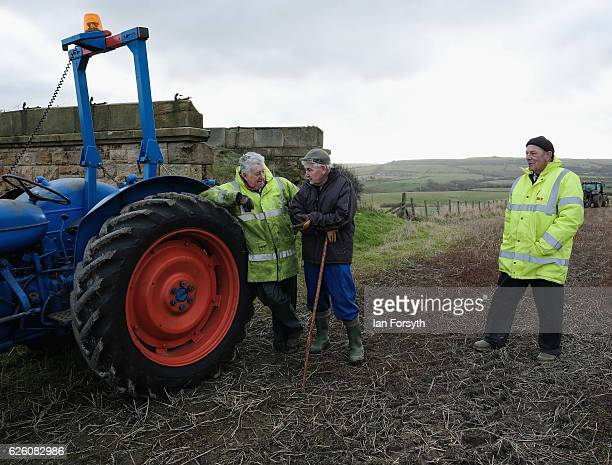 Spectators stand and talk during the annual ploughing match on November 27, 2016 in Staithes, United Kingdom. The event which is held each year in...