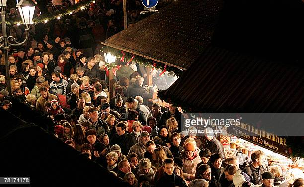 Spectators stand in the narrow alleys of the Christmas Market prior its opening ceremony on November 30 2007 in Nuremberg Germany The worldfamous...