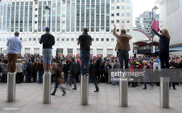 Spectators stand on bollards to get a better view during the Virgin London Marathon 2012 on April 22 2012 in London England