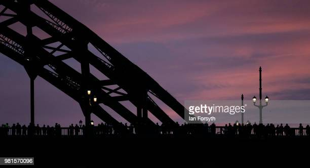 Spectators stand on the Tyne Bridge watching the performance during the opening ceremony of the Great Exhibition of the North on June 22, 2018 in...