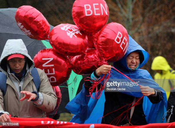 Spectators struggle with wind and rain on Heartbreak Hill during the Boston Marathon in Newton Mass April 16 2018