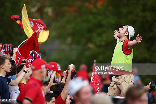 Spectators support their team during the round two ALeague match between Adelaide United and the Western Sydney Wanderers at Coopers Stadium on...