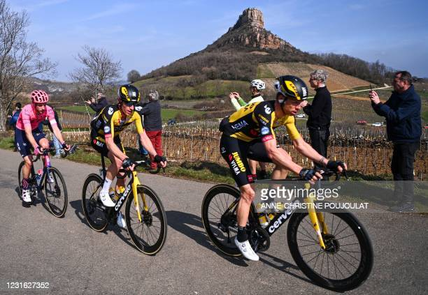 Spectators take pictures as Team Jumbo rider Germany's Tony Martin and Team Jumbo rider Netherlands' Jos van Emden compete in the pack with the Rock...