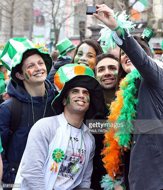 Spectators take selfies as The St Patrick's day parade makes its way along O'Connell Street as the largest St Patrick's day celebrations in Ireland...