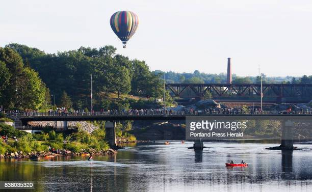 Spectators take to bridges and boats to view the skies at the Great Falls Balloon Festival