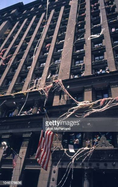 Spectators throw ticker tape out of the windows of an office building on Broadway's Canyon of Heroes during a parade for Desert Storm veterans New...