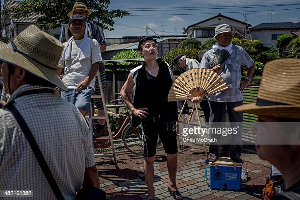 Spectators try to get a view of the armed samurai parade during the Soma Nomaoi festival at Hibarigahara field on July 26 2015 in Minamisoma Japan...