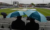 london england spectators under umbrellas before