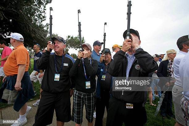 Spectators use periscopes to watch golfers on day one of the 108th US Open at Torrey Pines Golf Course in La Jolla California US on Thursday June 12...