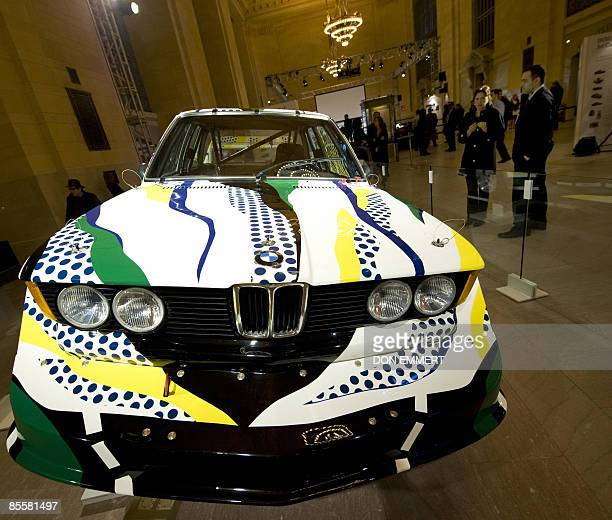 Spectators view a BMW painted by artist Roy Lichtenstein in 1977 at a display in Grand Central Terminal March 24 2009 in New York Four iconic BMW Art...