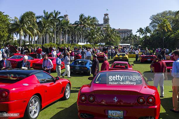 Spectators view a field of new and antique Ferrari automobiles at the annual Cavallino Auto Competition January 26 2013 held at The Breakers Hotel in...
