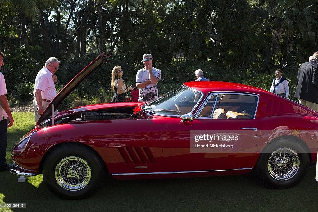 Spectators view an antique Ferrari 275 GTB/4 automobile at the annual Cavallino Auto Competition, January 26, 2013 held at The Breakers Hotel in Palm Beach, Florida.