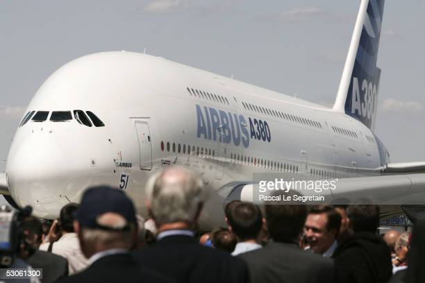 Spectators view the Airbus A380 the world's largest passenger liner during the plane's first public appearance at the 46th Paris Air Show June 13...