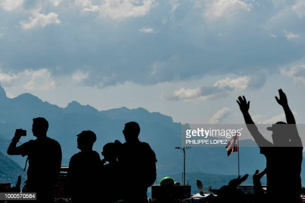 France's Lilian Calmejane rides in the ascent of the Col de Bluffy pass during the tenth stage of the 105th edition of the Tour de France cycling...