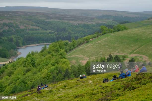 Spectators wait for an RAF Typhoon to fly over the Derwent Dam in the Upper Derwent Valley on May 16 2018 in Sheffield England The Typhoon replaced a...