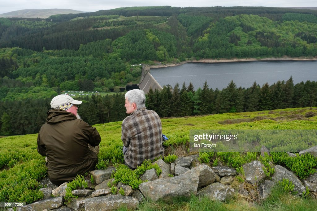 Spectators wait for an RAF Typhoon to fly over the Derwent Dam in the Upper Derwent Valley on May 16, 2018 in Sheffield, England. The Typhoon replaced a planned flight by a Lancaster bomber from the Battle of Britain Memorial Flight to mark the 100th anniversary of the Royal Air Force and the 75 anniversary of the 617 Squadron Dam busters operation during World War Two but was cancelled due to strong winds. Operation Chastise was an attack on the German dams Mohne, Edersee and Sorpe in the Ruhr Valley on 16 - 17 May 1943 by No 617 Squadron Royal Air Force, later called the Dam Busters. Using purpose built bouncing bombs developed by Barnes Wallis they used the Derwent reservoir as one of the practice locations before the attack. The flight over the dam was organised by the Royal Air Force Battle of Britain Memorial Flight and the bomber made two passes during the sortie before returning to RAF Coningsby.