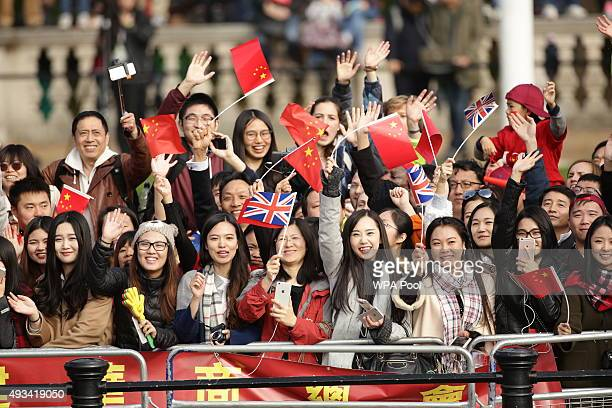 Spectators wait for Queen Elizabeth II and President of The People's Republic of China, Mr Xi Jinping, to pass along The Mall after the ceremonial...
