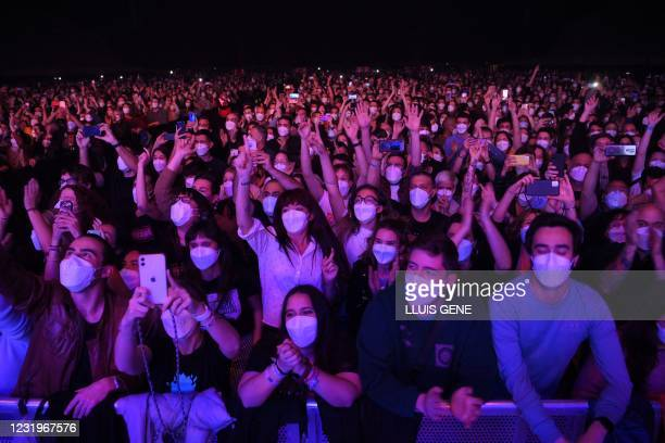 Spectators wait for the start of a rock music concert by Spanish group Love of Lesbian at the Palau Sant Jordi in Barcelona on March 27, 2021. -...