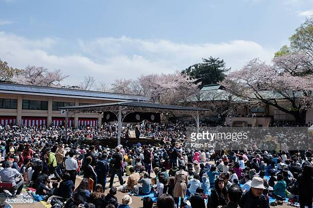 Spectators wait for the sumo tournament to begin during the Ceremonial Sumo Tournament or Honozumo at the Yasukuni Shrine on April 4 2014 in Tokyo...