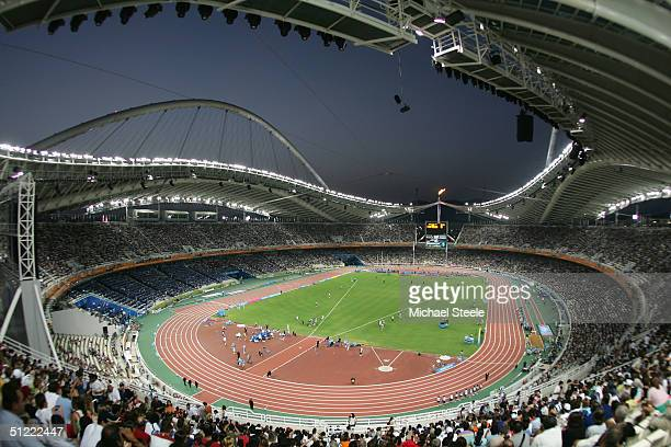 Spectators wait for the women's 1,500 metre semifinal to start on August 26, 2004 during the Athens 2004 Summer Olympic Games at the Olympic Olympic...