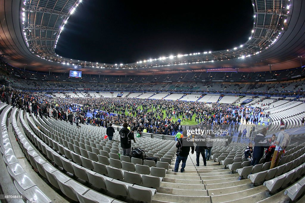 Spectators wait on the pitch during the International Friendly game between France and Germany at Stade de France on November 13, 2015 in Paris, France. The game was halted following an explosion in the stadium and attacks across Paris claiming the lives of at least 118 people.