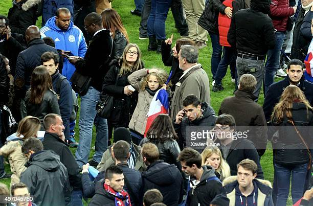 Spectators wait on the pitch of the during the International Friendly game between France and Germany at Stade de France on November 13, 2015 in...