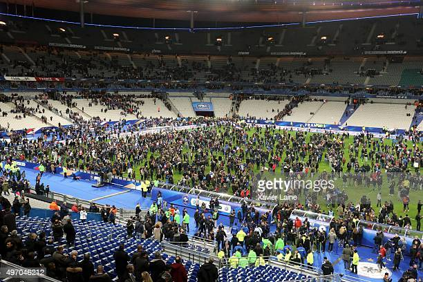 Spectators wait on the pitch of the during the International Friendly games between France and Germany at Stade de France on November 13 2015 in...