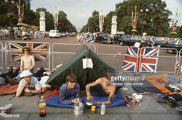 Spectators waiting for the wedding procession of Charles Prince of Wales and Lady Diana Spencer London 29th July 1981