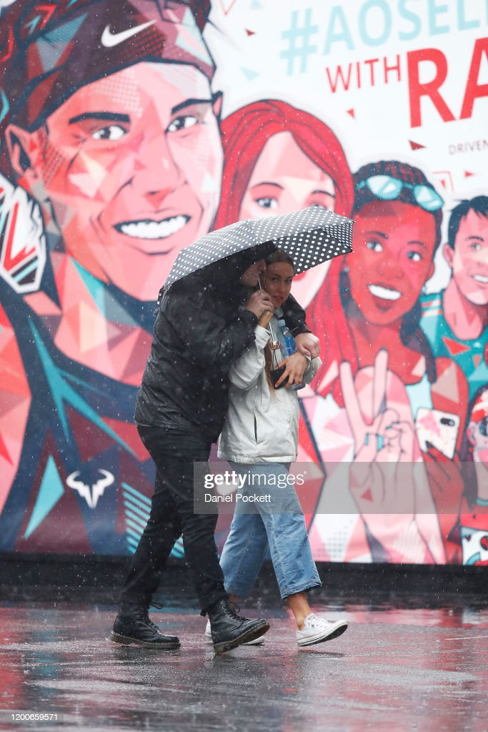 Spectators Walk As Rain Falls On Day One Of The 2020