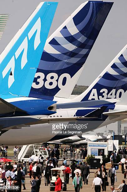 Spectators walk beneath the tail of the Airbus A380 the world's largest passenger liner during the plane's first public appearance at the 46th Paris...