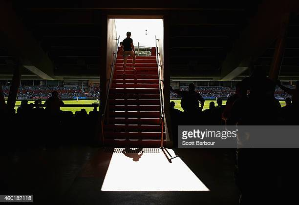 Spectators walk down a stairway of a grandstand during day one of the First Test match between Australia and India at the Adelaide Oval on December 9...