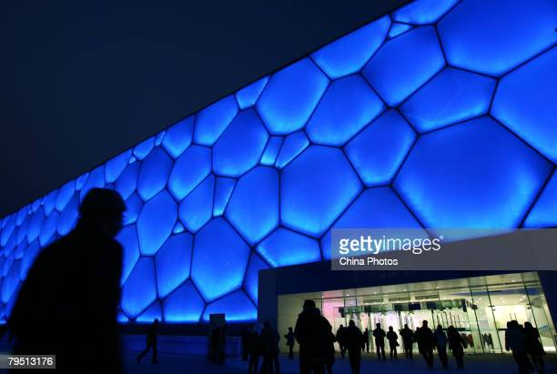 Spectators walk into the National Aquatics Centre dubbed the Water Cube to watch the 'Good Luck Beijing' World Swimming China Open on February 4 2008...