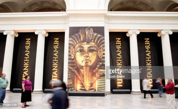 Spectators walk past a display for the King Tut exhibit at the Field Museum on May 25, 2006 in Chicago, Illinois. The exhibit, which opens to the...