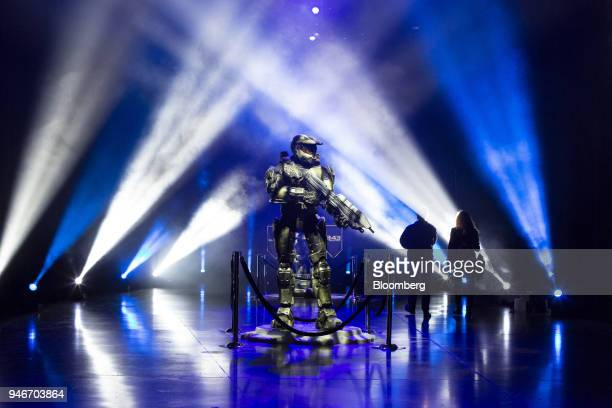 Spectators walk past a statue as they enter the Halo World Championship finals in Seattle Washington US on Sunday April 15 2018 Esports revenue...