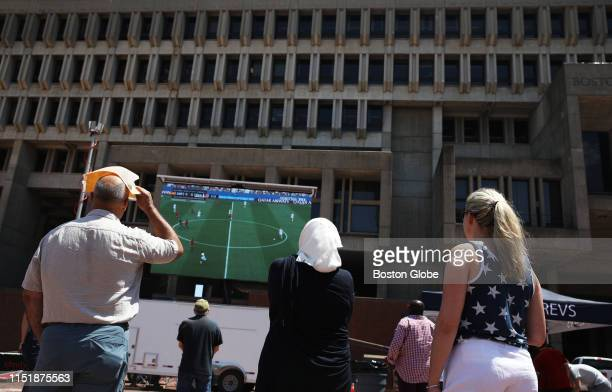 Spectators watch a broadcast of the Women's World Cup match between the defending champion US national soccer team and Spain at Boston City Hall on...