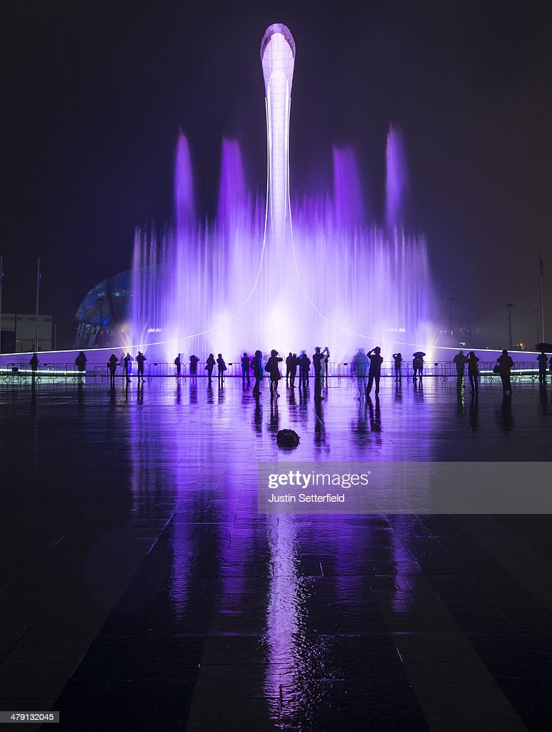 Spectators watch a fountain display following the Closing Ceremony of the 2014 Paralympic Winter Games on March 16, 2014 in Sochi, Russia.