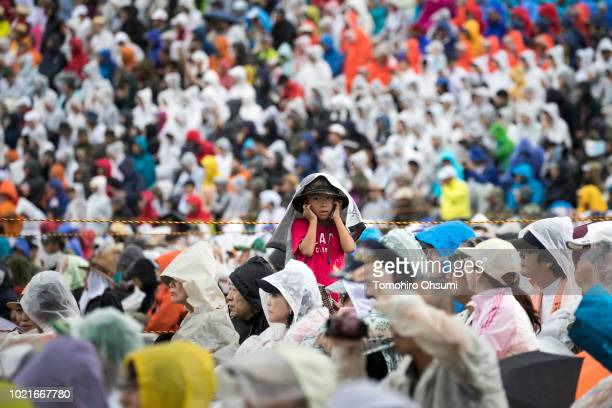 Spectators watch a Japan Ground SelfDefense Force live fire exercise at the foot of Mount Fuji in the Hataoka district of the East Fuji Maneuver Area...