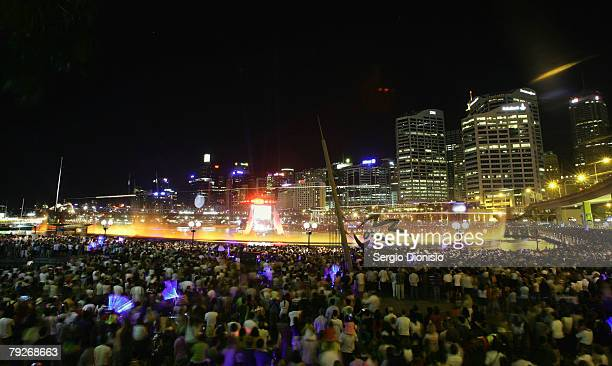 Spectators watch a laser light show at Cockle Bay on Darling Harbour during the Australia Day celebrations on January 26 2008 in Sydney Australia