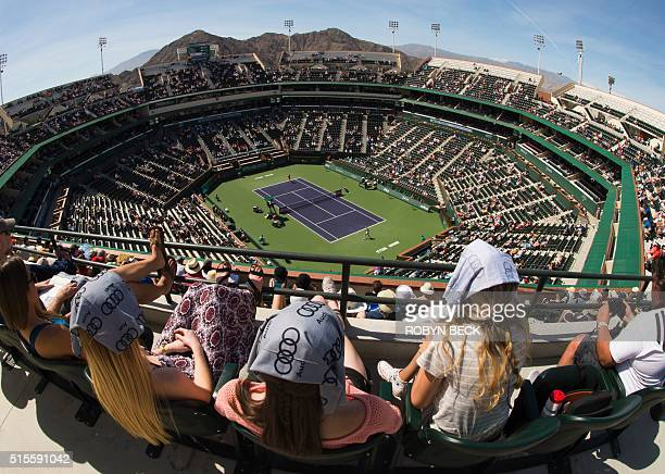 TOPSHOT Spectators watch a match between Ana Ivanovic of Serbia and Czech player Karolina Pliskova during at the BNP Paribas Open at the Indian Wells...