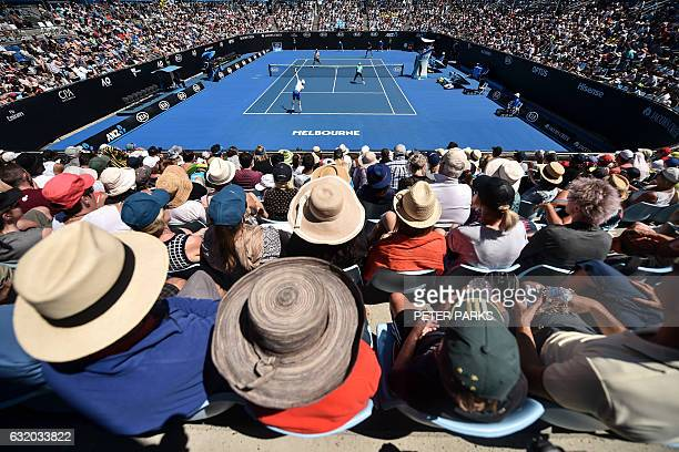 TOPSHOT Spectators watch a men's doubles match on day four of the Australian Open tennis tournament in Melbourne on January 19 2017 / AFP / PETER...