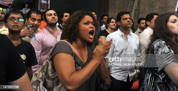 Spectators watch a Mixed Martial Arts bout during the FCC 6 fight night in Mumbai on June 30, 2012. Fight nights are gaining popularity in Mumbai as...