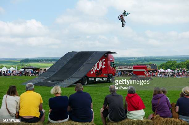 Spectators watch a motor cycle stunt display during the Duncombe Park Country Fair on May 28 2018 in Helmsley England Set in the grounds of one of...