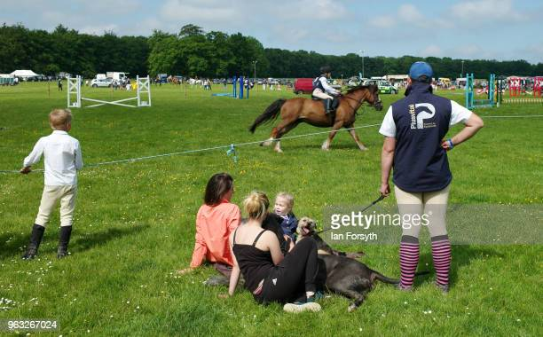 Spectators watch a show jumping event during the Duncombe Park Country Fair on May 28 2018 in Helmsley England Set in the grounds of one of...