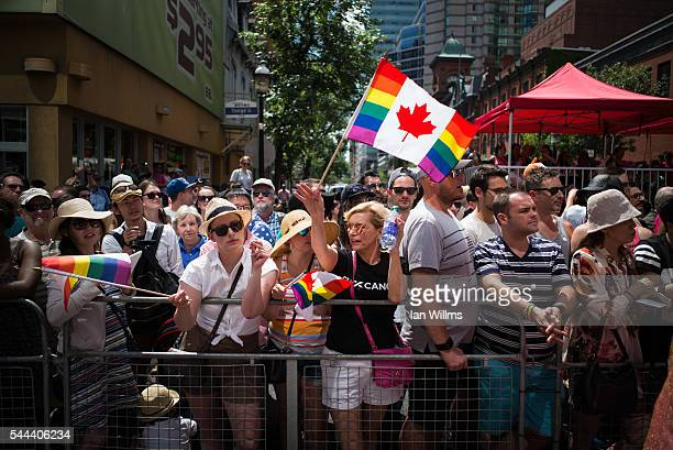Spectators watch along Yonge Street at the annual Pride Festival parade July 3 2016 in Toronto Ontario Canada Prime Minister Justin Trudeau will make...