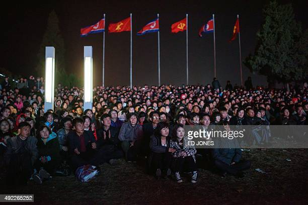Spectators watch an open air dance and music performance on the North bank of the Taedong river in Pyongyang on October 11 2015 North Korea is...