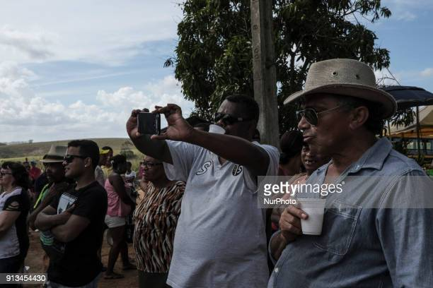 Spectators watch and take pictures of the performance of a group from Maracatu in the city of Nazaré de Mata in northeastern Brazil on January 14 2018
